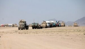 Marines from 2nd Maintenance Battalion, 2nd Marine Logistics Group (Forward), escort more than 35 local national trucks to forward operating bases in northern Helmand prov-ince, Afghanistan, during a resupply mission June 30 through July 6, 2011. (Photo by Sgt. Rachael Moore/Released)