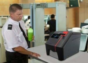 (Above and Below) Scantex proof-of-concept demonstrator in use by airport security for explosives testing. (Courtesy of Grey Innovation/Released)