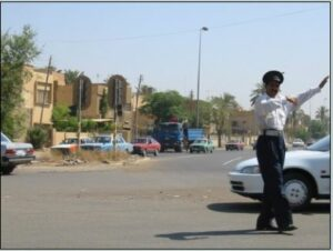 Traffic police at work before De-Baathification. Baghdad, June 2003. (Courtesy of Holly Hughson/Released)