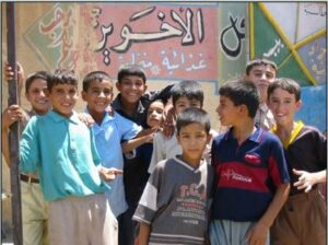 Boys outside an ice cream shop in Erbil. August, 2003. (Courtesy of Holly Hughson/Released)