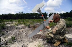 U.S. Air Force Tech. Sgt. Matthew Green fastens the GPS mech-anism inside a RQ-11B Raven B unmanned aerial vehicle at the Eglin range, Fla., Aug. 9. The UAV comes equipped with a GPS in order to track the aircraft when maintaining a visual may not be possible. (U.S. Air Force Photo by Airman Gustavo Castillo/Released)