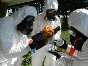 Troops transfer a sample of simulated nuclear fallout dur-ing an exercise that helped test the Defense Department's chemical, biological, radiological, and nuclear enterprise, July 28, 2012. (U.S. Army photo by Lt. Col. Carol McClel-land/Released)
