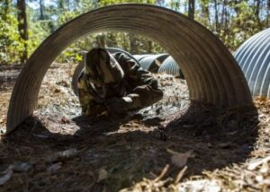 Figure 1. CBRN defense training at Camp Lejeune, NC, March 11, 2014. (U.S. Marine Corps photo by Lance Cpl. Joshua W. Brown/Released)