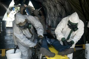Figure 3. Members of the 101st CBRN Company are trained during a mass casualty decontamination validation class, July 20, 2011. (Photo by Kevin Goode/Released)