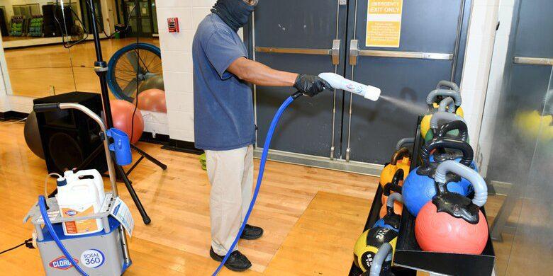 Electrostatic sprayer (U.S. Air Force photo by Joseph Mather, https://media.defense.gov/2020/Jul/24/2002463581/780/780/0/200722-F-ED303-1001.JPG).