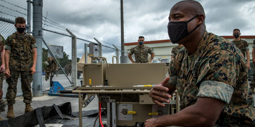 U.S. Marine Corps Sgt. Calvin Gravette III, a bulk fuel specialist with Bulk Fuel Company, 9th Engineer Support Battalion, 3rd Marine Logistics Group (MLG), instructs Marines on the Expeditionary Mobile Fuel Additization (EMFAC) on Camp Hansen, Okinawa, Japan, May 12, 2021. Gravette is a graduate from the EMFAC New Equipment Training and is the lead EMFAC training instructor for III Marine Expeditionary Force (MEF). 3rd MLG, based out of Okinawa, Japan, is a forward deployed combat unit that serves as III MEF's comprehensive logistics and combat service support backbone for operations throughout the Indo-Pacific area of responsibility (U.S. Marine Corps photo by Lance Cpl. Courtney A. Robertson).