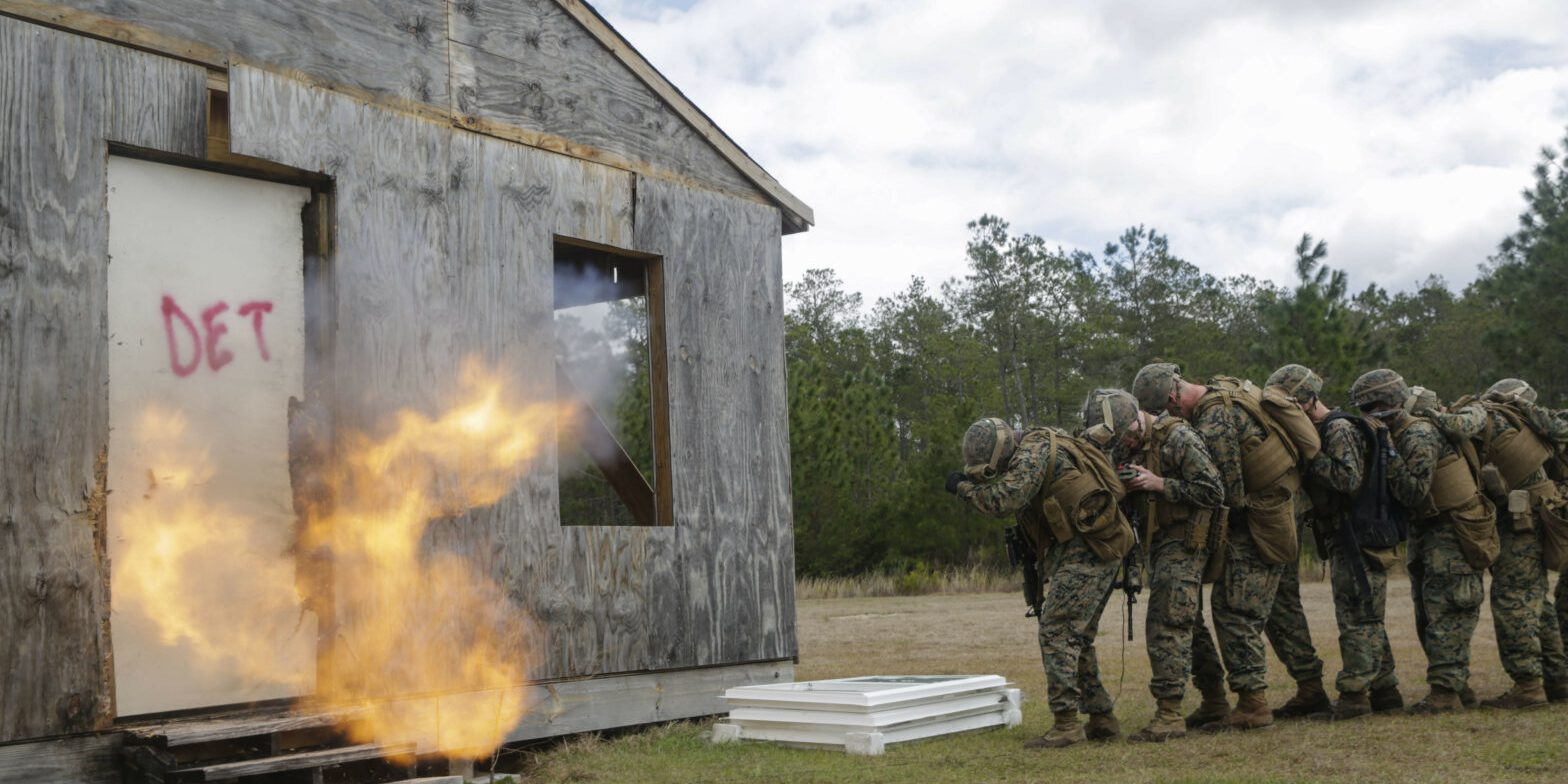 U.S. Marines from different units detonate a breaching charge during an urban breaching range at Camp Lejeune, N.C., March 20, 2018. Marines from both 2nd Combat Engineer Battalion and 3rd Battalion, 6th Marine Regiment, 2nd Marine Division conducted the training together to further improve proficiency in creating and using explosive breaching charges as well as improving unit cohesion. (U.S. Marine Corps photo by Lance Cpl. Leynard Kyle Plazo)